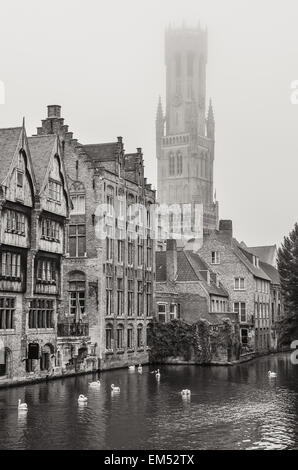 Bruges water canal and Belfry tower in monochrome - Stock Photo