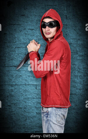 man with a knife in his hand - Stock Photo