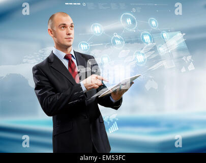 Businessman with tablet pc - Stock Photo