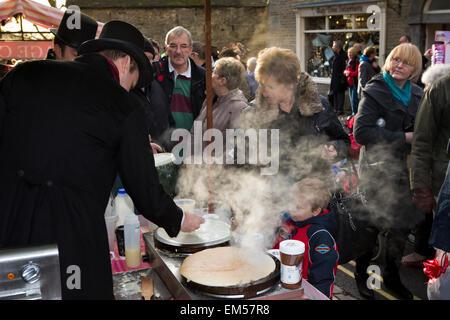 UK, England, Yorkshire, Grassington, Dickensian Festival, Main Street, pancakes cooking on crepe stall