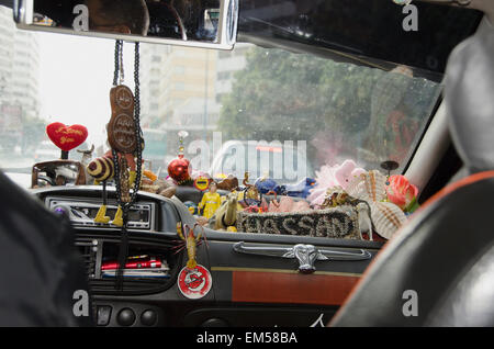 Morocco, Casablanca, Taxi with it's dashboard filled with various trinkets - Stock Photo