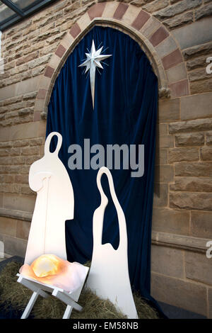 UK, England, Yorkshire, Harrogate, St Peter's Church, minimalist nativity with illuminated crib - Stock Photo