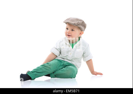 Handsome little boy in a cap - Stock Photo