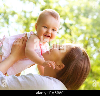 Beautiful Mother And Baby outdoors. Nature - Stock Photo