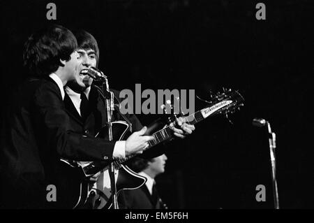 British pop group The Beatles performing on stage in Las Vegas during their visit to the USA. Paul McCartney and - Stock Photo