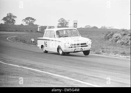 Jim Clark in the Team Lotus Cortina seen here lifting a wheel through the esses at Snetterton during the Saloon - Stock Photo
