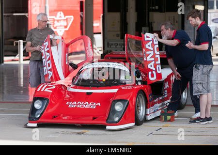 Jon Fay and his pit crew,  prepare  this  group C  Tiga, race car for some fast laps  around the famous Silverstone - Stock Photo