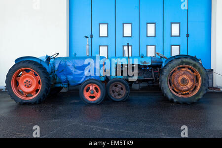 Two fishermen's tractors parked on the promenade when a high tide and storm suspected - Stock Photo