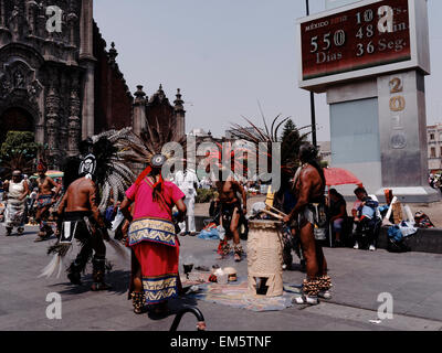 native Aztec dancers dancing performing in feathered headdress in the Zocalo, Mexico City, Mexico, North America - Stock Photo
