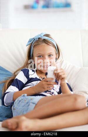 Child listening music - Stock Photo
