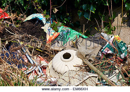 rubbish that has been dumped in the british countryside - Stock Photo