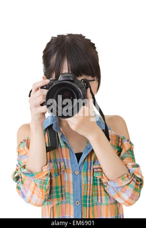 Asian woman takes images with photo camera - Stock Photo