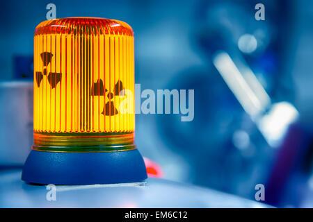 Warning lamp radioactive radiation - Stock Photo