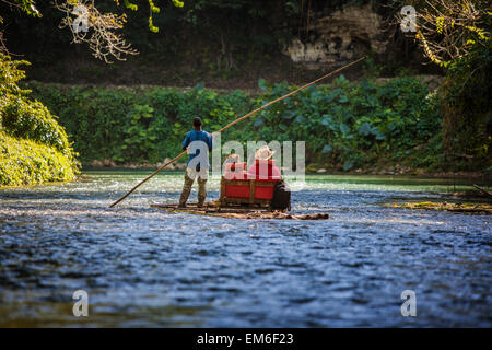 Tourists on Martha Brae River in Jamaica - Stock Photo