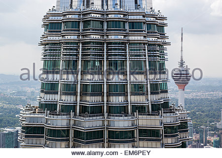 A close up view of the Petronas Towers in Kuala Lumpur, Malaysia with the KL Tower Space Needle next to it. - Stock Photo