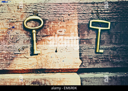 Old lost keys on floorboards closeup - Stock Photo