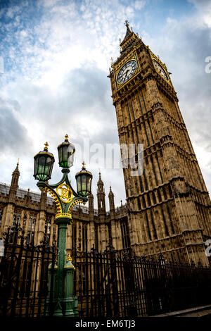 Big Ben and the golden and green lamp post. London is truly magical city in England. Its timeless architecture stands - Stock Photo