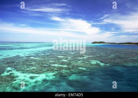 Fiji, View from ocean to Mana Island; Mamanuca Islands - Stock Photo