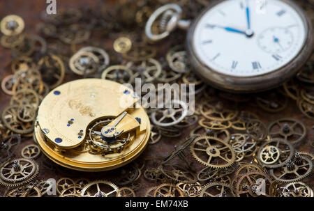 Old pocket watches, movements and cogs - Stock Photo