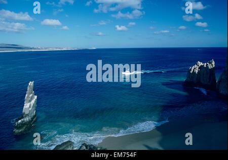 Mexico, Cabo San Lucas, Land's End, Fishing Boat On Blue Ocean Near Beach. - Stock Photo