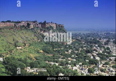 India, City Of Gwalior, Man Singh Palace On Hillside Above, Clear Blue Skies. - Stock Photo