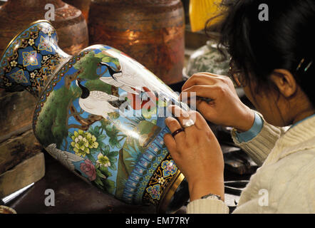 China, Shanghai, Cloissone Making, Woman Working On Fine Details Of Painting No Model Release - Stock Photo