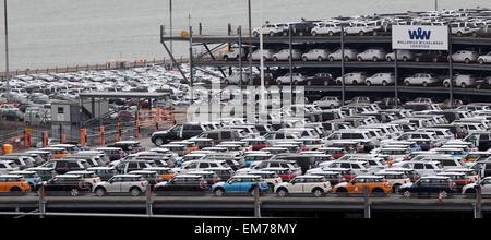 Southampton Docks Mini and Land Rover cars parked at Wallenius Wilhelmsen logistics awaiting export via a car transporter - Stock Photo
