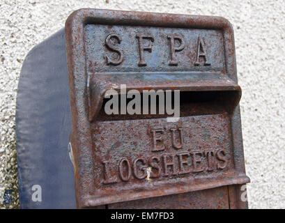 Scottish Fisheries Protection Agency postbox for fishermens' EU logsheets,  Kirkwall harbour, Orkney, Scotland - Stock Photo