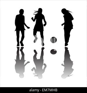 girls playing football - Stock Photo