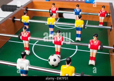 playing toy football players for everyone even in household conditions - Stock Photo