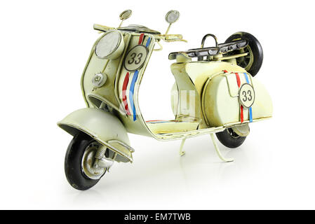 Old retro toy motorcycle isolated on white background - Stock Photo