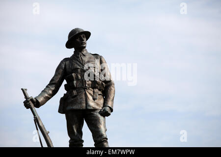Winchester WW1 Rifleman statue, Kings Royal Rifle Corps Memorial situated in the gardens of Winchester Cathedral, - Stock Photo
