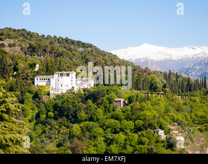Snow capped peaks of the Sierra Nevada mountains and the Alhambra  Generalife summer palace and gardens, Granada, - Stock Photo