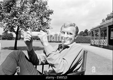 England captain Bobby Moore, relaxes the day before his side plays West Germany in the World Cup Final at Wembley. - Stock Photo