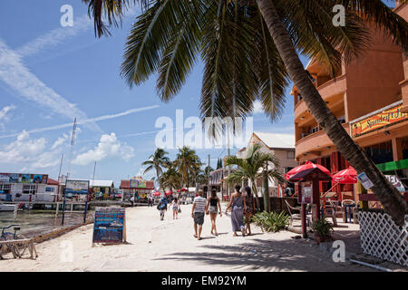 Looking down the beach, downtown, San Pedro, Ambergris Caye, Belize, South America - Stock Photo