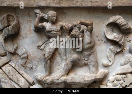 Roman sarcophagus. Myth of Theseus and Ariadne. Marble. C.130-140 AD. Theseus killing the Minotaur. - Stock Photo
