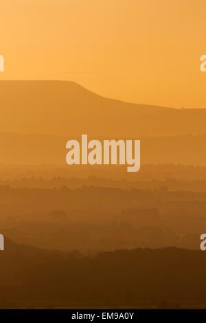 Late evening view from Malvern Hills overlooking Herefordshire after sun set over Hay Bluff Brecon Beacons in Powys - Stock Photo