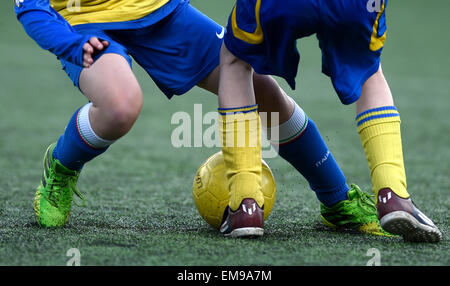 A cropped shot of two female soccer players attacking the ball. - Stock Photo