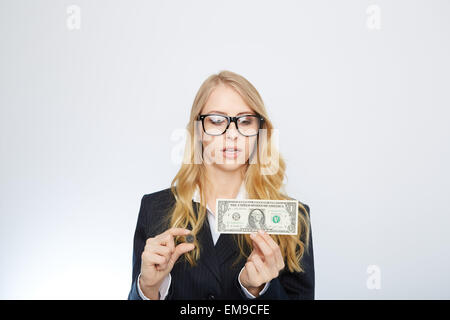 Attractive business woman.  Holding a one dollar and euro. - Stock Photo