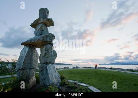 Inukshuk In English Bay At Dusk, Vancouver, British Columbia, Canada - Stock Photo