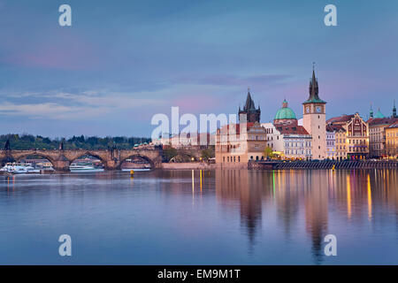 Prague. Image of Prague riverside and Charles Bridge, with reflection of the city in Vltava River. - Stock Photo