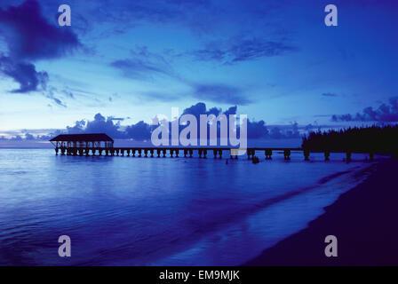 Hawaii, Kauai, Hanalei Bay, Pier At Twilight, Deep Blue Sky And Ocean. - Stock Photo