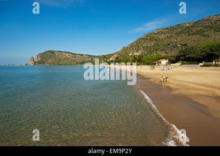 Sandy beach near Terracina, lido di Fondi, on the back the promontory of Sant'Angelo mountain,  Lazio, Italy - Stock Photo