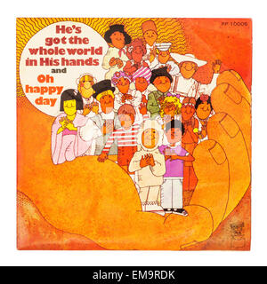 A Childrens Vinyl record called He's got the whole world in his hands on a white background - Stock Photo