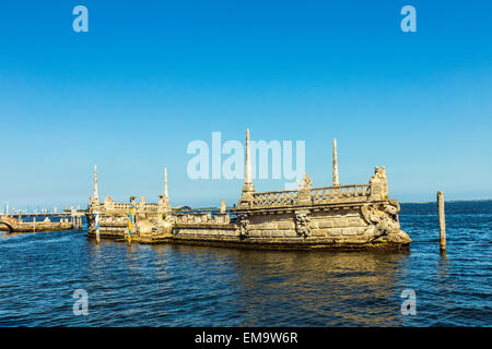 Stone breakwater barge at the Vizcaya Museum and Gardens on Biscayne Bay in the present day Coconut Grove neighborhood - Stock Photo