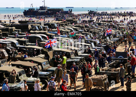 Collection of vintage WW2 vehicles on allied beaches D Day Anniversary Celebrations and Ceremony at Arromanche, - Stock Photo