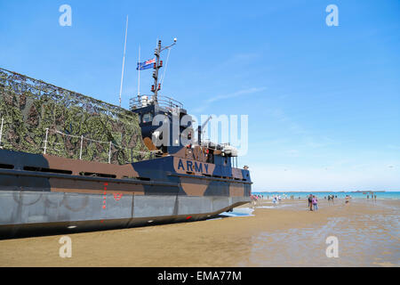 An army landing craft vessel on Allied beaches D Day Anniversary Celebrations and Ceremony at Arromanche, Normandy - Stock Photo