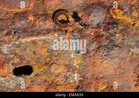 rusty pattern hole on a steel plate - Stock Photo