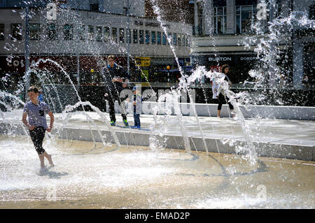 Nottingham, UK. 18th April, 2015. UK Weather: Bright sunny day brings out the crowds in the center of Nottingham.Young - Stock Photo