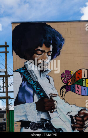 Jimmy Hendrix figure painted on the exterior wall of a building in the industrial heart of Vancouver - Stock Photo